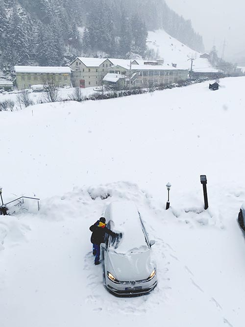 cleaning up the snow before going skiing in Austria